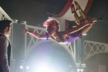 DF-11638_R – Philip (Zac Efron) is entranced by Anne's (Zendaya) trapeze artistry in Twentieth Century Fox's THE GREATEST SHOWMAN.